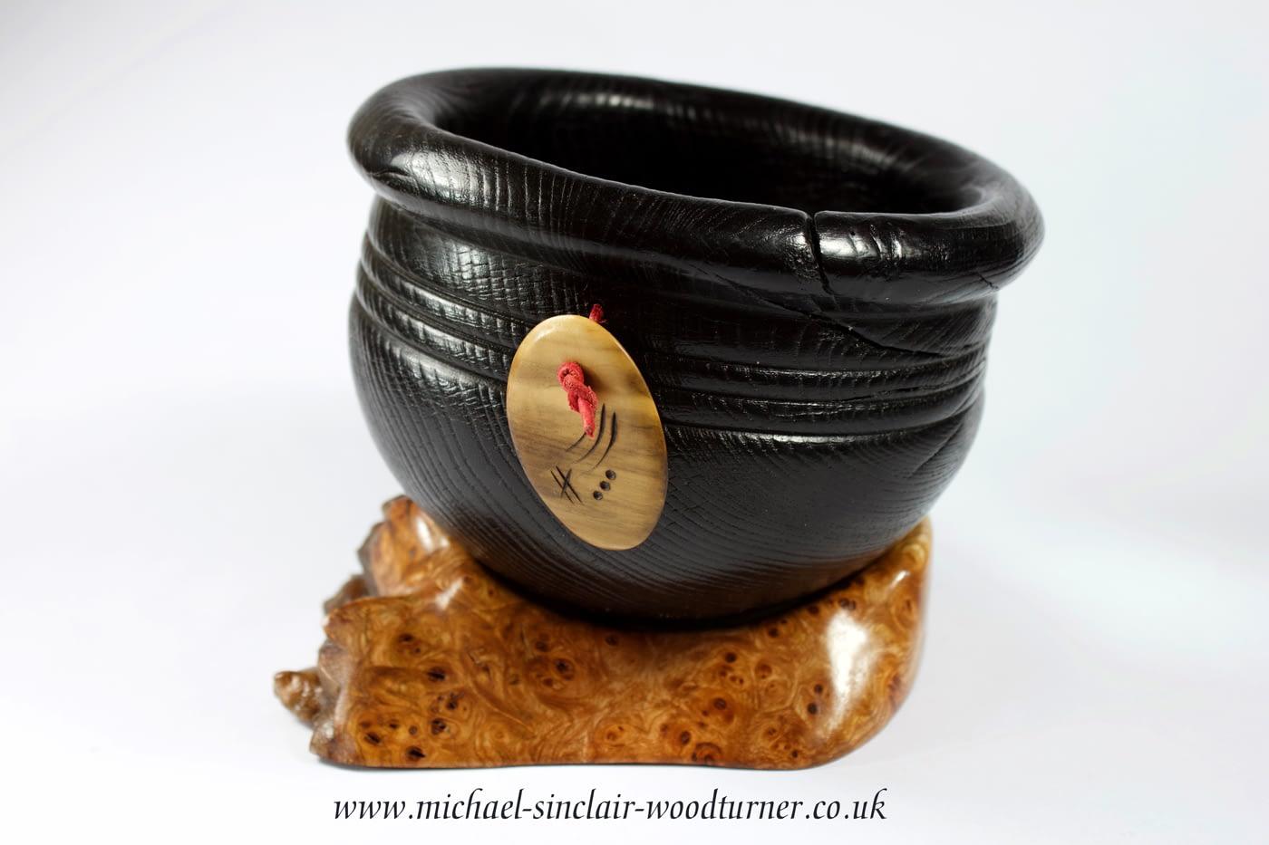 Ebonised bowl with boxwood amulet
